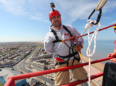 Andy Reid taking part in an abseil