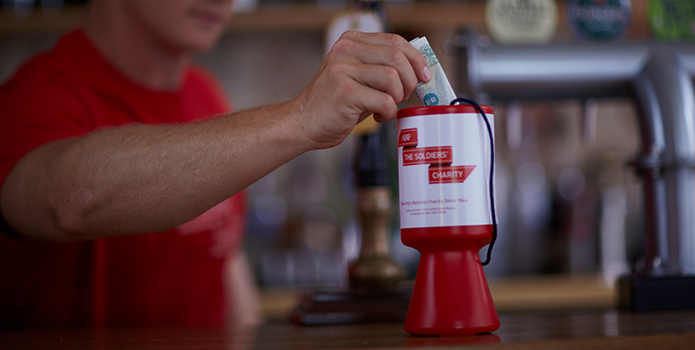 Fundraising tin at the bar