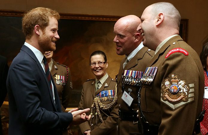HRH Prince Harry talks to WO1 (GSM) Andrew 'Vern' Stokes,Garrison Sergeant Major, London District and WO1 Glenn Haughton, trustee of ABF The Soldiers' Charity