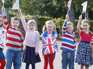 Children celebrating Red White and Blue Day