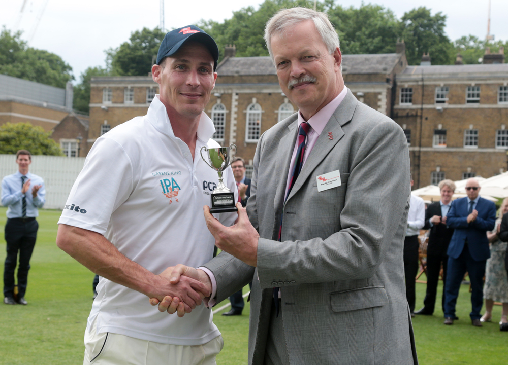 Simon Jones receives the City Invitational Cup from Robin Bacon, ABF The Soldiers' Charity
