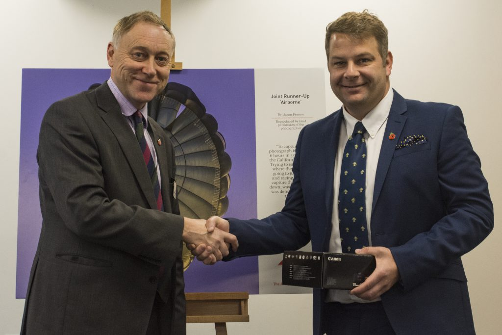 Jason Fenton receives his prize from Col (Ret'd) Barney Haugh CBE
