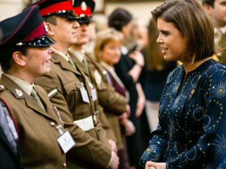 Princess Eugenie speaking to a soldier
